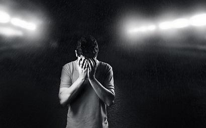 a sad boy standing alone
